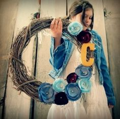 satin & buttons for flowers, wooden letter, modge podge, and grapevine wreath