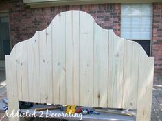 Inexpensive DIY Wood Headboard Made Out Of Cedar Fence Boards or this shape padded.