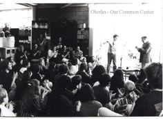 """ID#0240 Date: 1994-1996. This photo show Alan Ginsburg and his audience during a March reading on the second floor of the Co-op bookstore. He visited Oberlin around his trip to a Buddhist temple in Cleveland. Karen Long Interview 01/27/01; Oberlin Heritage Center: Fred Maddock files; McQueen, Albert, """"A Brief History of the Oberlin Consumers Cooperative and its Businesses.""""; Inge, Angela. """"A long Co-op History"""" Chronicle-Telgram, June 18, 2000."""