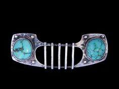 MURRLE BENNETT & Co. (1896-1914)   A Jugendstil silver brooch of winged shape, set two turquoise cabochon stones. Anglo/German c.1900. Marks for MB Co. and 950.   Size: Height 2 cm. Width 4.2 cm. (Fitted case)  Lit.: Art Nouveau Jewelry. Vivienne Becker. Liberty Style. Academy Edition.