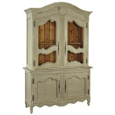 "Evoking the """"Belle Epoque"""" of France, the commodious cupboard features two pairs of gracefully detailed locking doors with a fixed shelf behind each pair. The scrolled details are highlighted with h"
