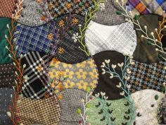 I like this old fashioned look-embroidery after pieced and quilted