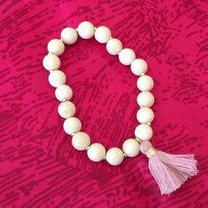 """""""Camila"""" Tassel Stretch Bead Bracelet, pink tassel So pretty on your wrist! This jade stone styled beaded bracelet is very stretchy, one size fits all. Fringe tassels in five colors. Handcrafted with love in the USA. Perfect as a gift for yourself and your BFFs. Bundle and save! Twilight Gypsy Collective Jewelry Bracelets"""