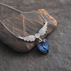 Deep blue glass heart with diamante wings