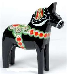 I have two black dala horses like this. One big and one small.