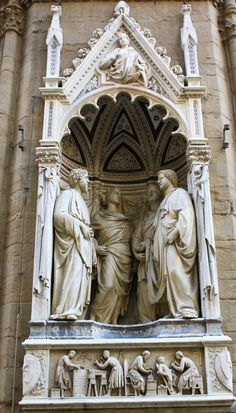 orsanmichele.  Four Crowned Saints group by Nanni di Banco.
