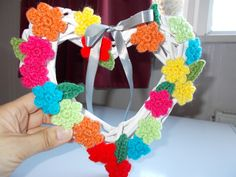 A little wicker heart covered with pretty little flowers and leaves.