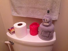 Ravelry: LadyMac111's wipe my shiny metal ass! It's the Bender Toilet Paper roll cozy!   Pattern is Bender, Guardian of the Bum Fodder by Elizabeth Jarvis. Crochet Geek possible auction item to make.