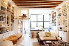 Loft of two interior designers. Most clever use of space I've seen - so clever, I would say it could be a cottage too. Kuddos to the designers.