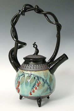 """""""Basket Handled Teapot with Red Berries"""" Ceramic Teapot ~ Created by Suzanne Crane ~ Crane's signature piece, the wheel thrown teapot with twining hand pulled stoneware handles now has ripe red berries to give it a little extra pop. Stoneware feet are textured with the same churchkey pattern as found on the lid and at the rim & base of the teapot body."""