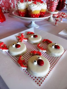 Rudolph Oreos: Oreos dipped in melted white almond bark, pretzel dipped ears sprinkled with red sugar, M & M candy nose, candy eyes. Cute!