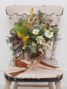 This bouquet was designed to be loose, organic, earthy and rustic. While subtle in colour, the richness of this bouquet lies in the varied texture of the flowers and foliage layered throughout. A wedding celebrated outside in a field, in an old barn or in the ruins of a historic, stone Mill would be the perfect setting for these flowers.