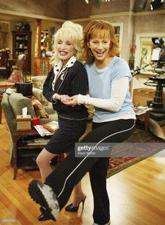 Singer Dolly Parton and Reba McEntire pose on the set of The WB's...