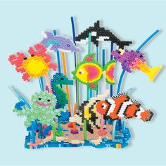 This bright underwater reef scene features lots of sea creatures including a clown fish, octopus, seahorse, crab, dolphin, and more. The scene is made dimensional with the use of bead stems that attach to each creature and anchor into the reef base.