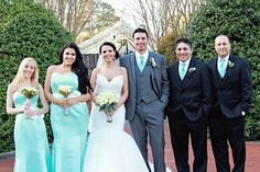 Picture of the bridesmaids and groomsmen. Bridesmaids have tiffany blue dresses with a white bow with bling on the bow. Groomsmen have black tuxes with tiffany blue ties   Groom has a gray tix with tiffany blue tie. All the men are in the same Vera wang tux but just a different color from the groom.