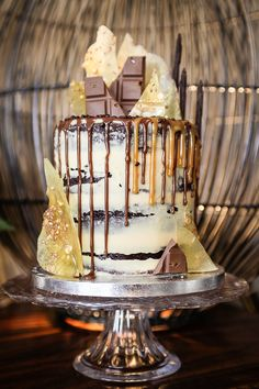 Artisana - Bespoke Cakes Chocolate Mud Cake with Salted Caramel Buttercream, Chocolate drip, Salted Caramel Sauce, sugar shards and handmade chocolate bars