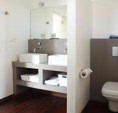 Heb je een kleine badkamer? Met deze 10 slimme trucs lijkt je badkamer gigantisch!