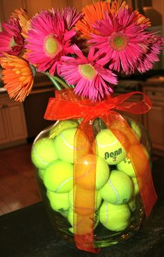 tennis balls in my party flowers it was a cute centerpiece.