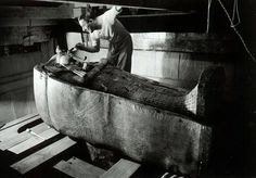 Howard Carter inspecting one of the coffins of Tutankhamun http://kenanaonline.com/posts/874832