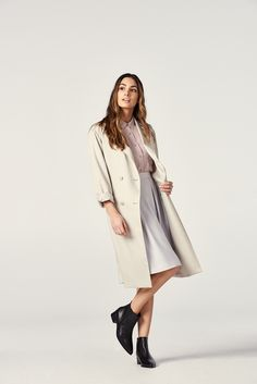 Feminine, elegant, and forever an iconic fashion staple. Layer up for spring in our Drape Trench Coat.