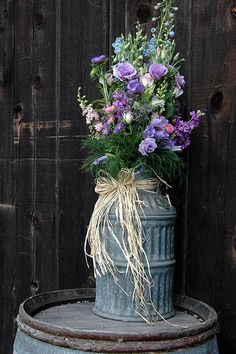 old butter churn with jute twine & flowers. I have 3, Holly
