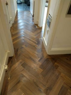 Walnut parquet wooden floor fitted by Fin Wood in a hall with a single border.