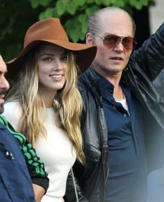 n This Photo: Johnny Depp, Amber Heard Actor Johnny Depp gets a visit from his fiance Amber Heard on the last day of filming for the upcoming movie 'Black Mass' in Lynn, Massachusetts on July 21, 2014. While Johnny filmed a scene where he goes down an alley with a plumbers wrench to hit someone, Amber and her sister Whitney chat it up with crew members.