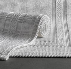 Cotton Woven Bath Rug - Restoration Hardware.  I swear by these...durable and easy to clean.