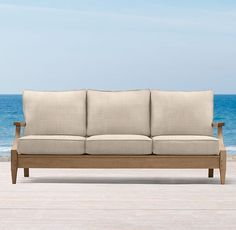 """RH's 78"""" Santa Monica Luxe Sofa:Our refined Santa Monica teak collection is classically styled with gracefully tapered legs and curved arms."""