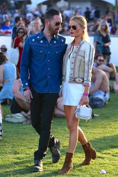 Celebrities at Coachella 2015 - Kate Bosworth wearing a white mini dress with an embroidered lace and suede jacket + brown booties