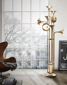 Botti Floor fixture is the newest version of Botti family: it embodies all the details of wind instruments, transporting us to a real music concert.