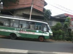 this is a picture of a bus called Kopaja, a local bus in Indonesia was taken on 11th October 2013. It shows us what kind of bus is in Jakata