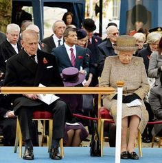 Queen Elizabeth and Prince Philip have a moment of silence to show their support for the people of Paris, especially the victims of the terrorist acts and their families, 8 January 2015.