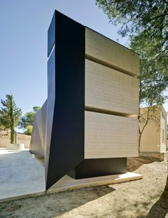 Spanish architects Amparo and Andres Martinez Vidal paired bulky concrete with delicately folded steel to create this mausoleum in Murcia