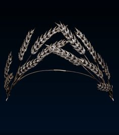 Late Georgian / early Victorian ears of Corn Tiara, first half of the 19th century. Gold, silver and diamond tiara, consisting of twelve ears of corn, six to each side, meeting at the centre of the narrow gold band.