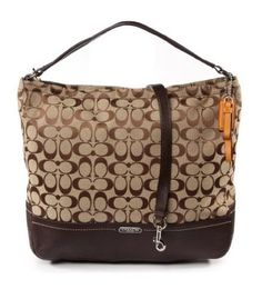 Wrapped in Coachs dual tone khaki Signature C print with mahogany brown leather trim and polished silver tone hardware. Fabric is specially treated to repel water. The lined interior features a zippered pocket and two multifunction slip pockets. Fully zippered top. Single handle with a drop of at least 7 the bag is unstructured at the top so itll slouch a little for a greater drop if not full. Or use the removable and adjustable shoulder  crossbody strap. Measures approximately 14 34…