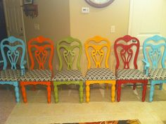 Multicolored Refinished Dining room chairs with matching chair pads. She put this with a refinished white dining room table.