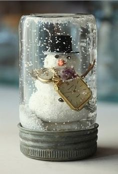 snow globe in a jar! All you need is the following:water,baby oil or mineral oil,hot glue gun, something youd like to display, that fits inside the jar, and decorative bits: glitter, fake snow (crushed egg shell works well), small beads, etc.