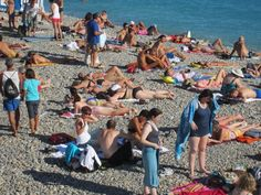 Beach Goers And Sun Worshippers On The Pebble Nice France