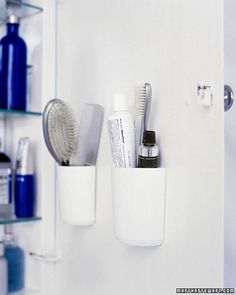 Medicine Cabinet Organizer - Combs, brushes, and toothpaste take up considerable space when laid horizontally on a shelf. Flat-backed, self-adhesive cups on the inside of the cabinet door hold them more efficiently. Before pressing the cups in place, line them up between the shelves. To ensure the door can close, put thin items on the shelves in the spots where the cups will take up some space.