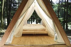 Lushna, Slovenia - Taking inspiration from a traditional tent, this cabin provides a superb solution to uneven camping ground on a Slovenian campsite.
