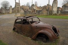 Abandoned town- Oradour-Sur-Glane, France. During the Nazi takeover and murder of the people of this town, this car drove into town, returning with some citizens. They were murdered and the car has stood in this place to this day.