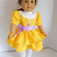 This is  a cute yellow American Girl dress. I like the lavender sash with it!