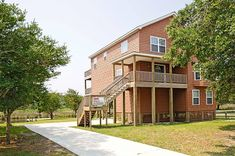 This comfortable and tastefully decorated canal front property is located in the popular Brigand's Bay area of Frisco, with paved streets perfect for walking or bike riding. The home offers both inside and outside options for your entertainment and relaxation including a shaded covered deck off the bedroom level, and a beautiful panoramic view of the wetlands and the Pamlico Sound in the distance from the top-level deck. Plus just steps from the door are a dock and boat slip where your boat…