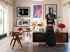 Kourtney in her home office, which is furnished with a vintage Jules Leleu desk and Pierre Jeanneret chairs; the arrangement of art includes Harry Benson's photograph of Mia Farrow and Frank Sinatra at Truman Capote's Black and White Ball; a vibrant work on paper by Bridget Riley; and Batman, a gelatin silver print by Herb Ritts.