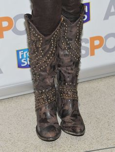 Country music singer Kellie Pickler (shoe detail) attends the unveiling of the Fresh Step Limited-Edition cat sweater at the ASPCA Adoption Center on January 24, 2012 in New York City.