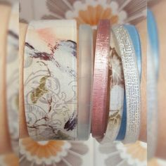 """Here is a beautiful Tuesday Color by Amber armparty. Our new Messenger cuff (and skinny) are so pretty and because of the fabric interlayer, each one will look different. Just looking at this """"wristful"""" of ecobling makes me feel serene and makes me want to find an outfit to finish the perfection. #ColorbyAmber #armparty #serenity #SpringStyle #cbamessengercuff #ecofriendly #jewelry"""