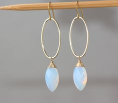 Faceted Opalite Moonstone Marquise glass beads 20 x 10 mm Gold plated Oval Hoops Connectors 30 x 15 mm.  Gold plated French Ear Wire.  The total length is 2.5 inches or 66 mm long. Your order will be shipped in a gift box!  ============================================================  Please enter my shop here - www.etsy.com/shop/ZarinaJewelry  or my FB page - facebook.com/ZarinaJewelry