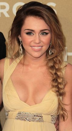 Love the ombre hair on her...