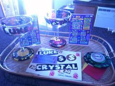 I put this together for my cousin-in-laws b-day parties.... Husband & wife born on the same day a year apart. (A few garage sale scores: glasses, tray & coasters) I bought 2 stand up frames, filled with lotto tickets, dice and poker chips to fill the glasses. Personialized & home-made card~ Unquie and loved!